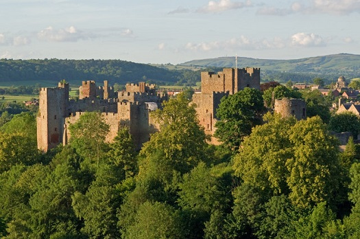 """Ludlow Castle from Whitcliffe, 2011"" by Ian Capper.  Licensed under CC BY-SA 2.0 via Wikimedia Commons"