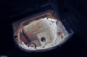 This priest hole is hidden beneath in a spiral stone staircase in Sawston Hall.