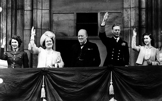 (left to right) The then Princess Elizabeth, Queen Elizabeth, Sir Winston Churchill, King George VI and Princess Margaret celebrate before and with Londoners upon the balcony of Buckingham Palace on V.E. Day, May 8, 1945.
