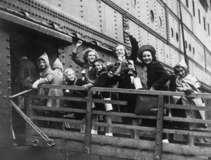 British children board a ship on their way to Canada.