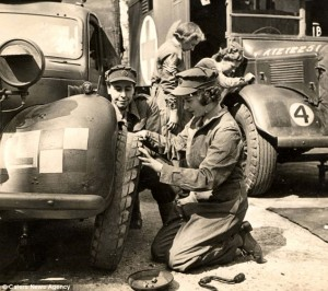 Princess Elizabeth changing a tire while serving in the Auxiliary Territorial Service