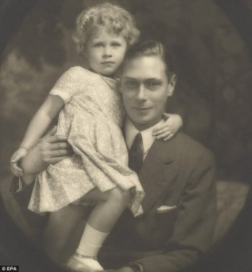 The then Princess Elizabeth held by her father,  then Prince Albert, Duke of York.
